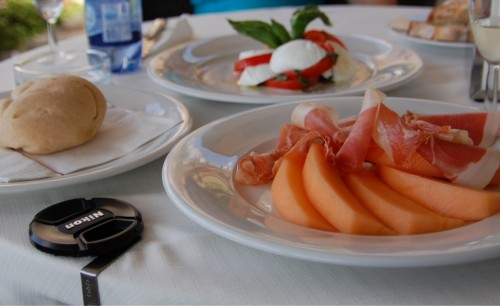An Italian lunch of proscuitto e melone and caprese salad