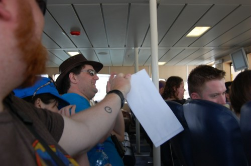 Joel hands out barf bags on the boat ride to Robben Island