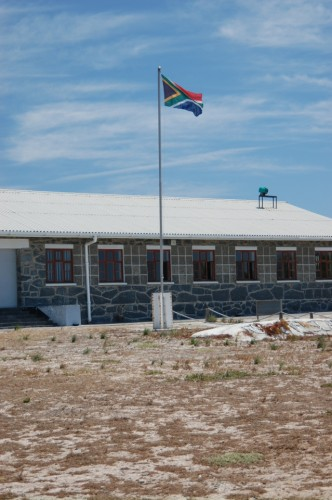 New South African flag outside of the Robben Island Prison