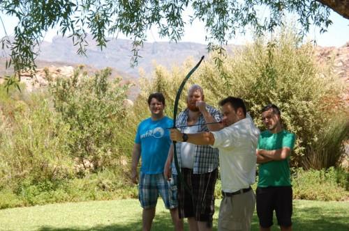 Malcolm teaches Joel archery